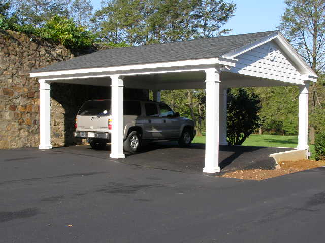 Custom garage pictures photos pictures of garages for Carport with attached workshop
