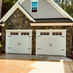 stone and vinyl detailing on a custom garage