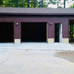 purple garage with an overhang