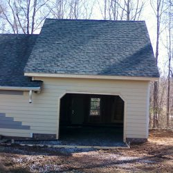 finishing the siding on a one car garage