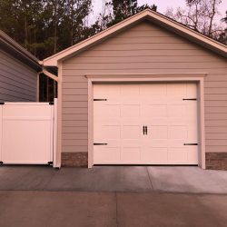 1-car garage with attached gate to house