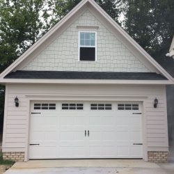 2-story garage with light brick trimming