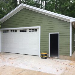 front door access to a 1-car garage
