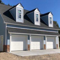 3 car garage, above garage room, blue custom garage, detached garage