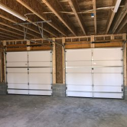 inside view of a 2-car garage with automatic door opener